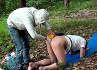 Doggystyle enema in the forest