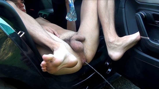 Squirting boy in the parked car